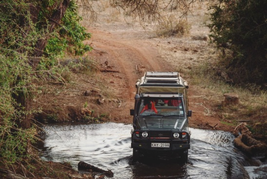 Driving through Meru's several rivers